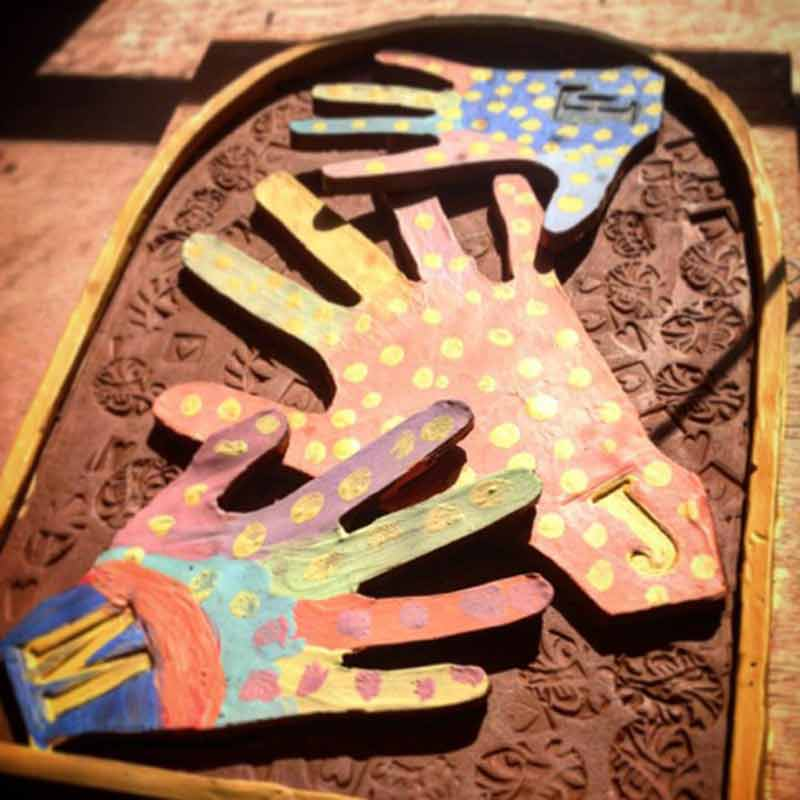 brightly painted pottery hands made by children and adults during one of our fun family workshops in wiltshire uk