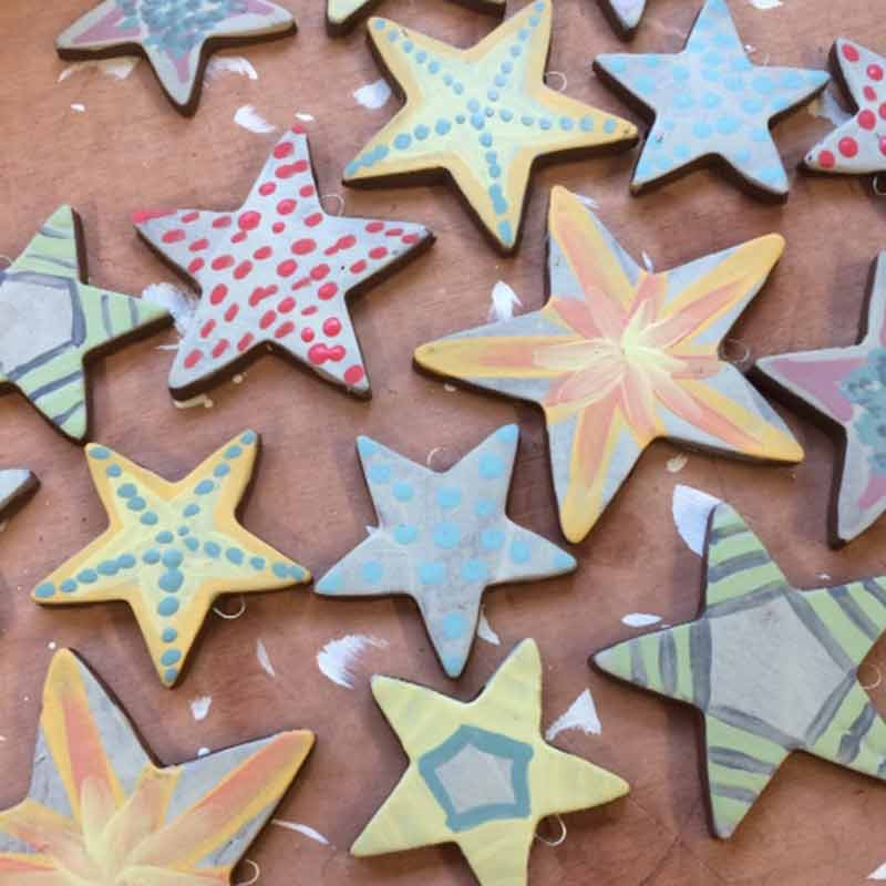 ceramic stars made during our christmas decorations workshop in wiltshire uk