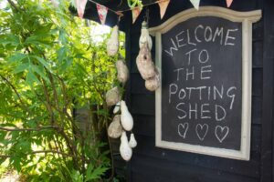Image of the board outside the pttery stio which reads 'welcome to the potting shed' and is where Jane runs her workshops in pottery and ceramics in the uk