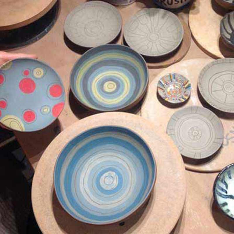 Tapas dishes which have been thrown on a potters wheel by students in a pottery class in wiltshire uk