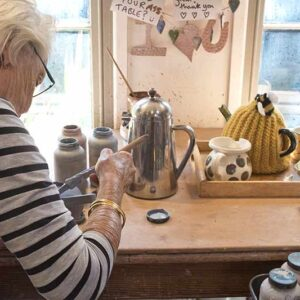 A student uses the studio independently to make ceramics and pots near bath uk