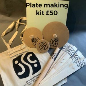 3 round clay moulds with the jane scott ceramics logo stamped on them, with a tote bag and various other ceramics equipment as in the description, which comprise our platemaking kit