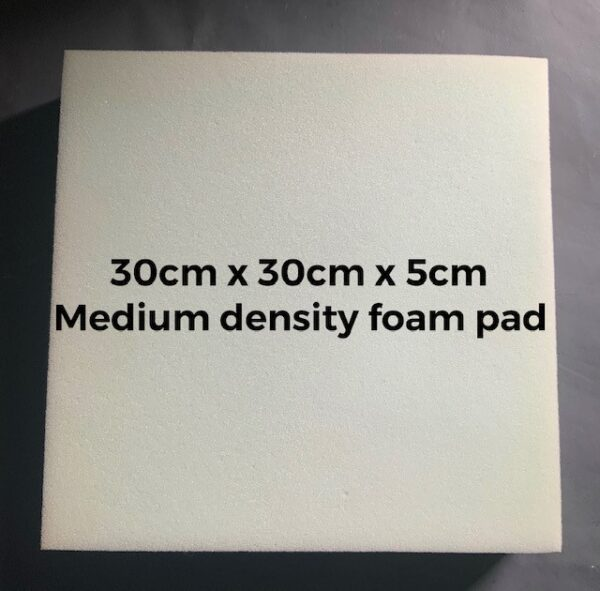 a blue square foam pad with descriptive text showing the size