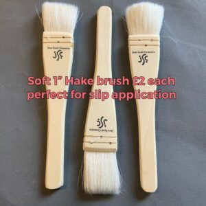 three wooden hake goathair brushes with jane scott ceramics logo displayed in a row