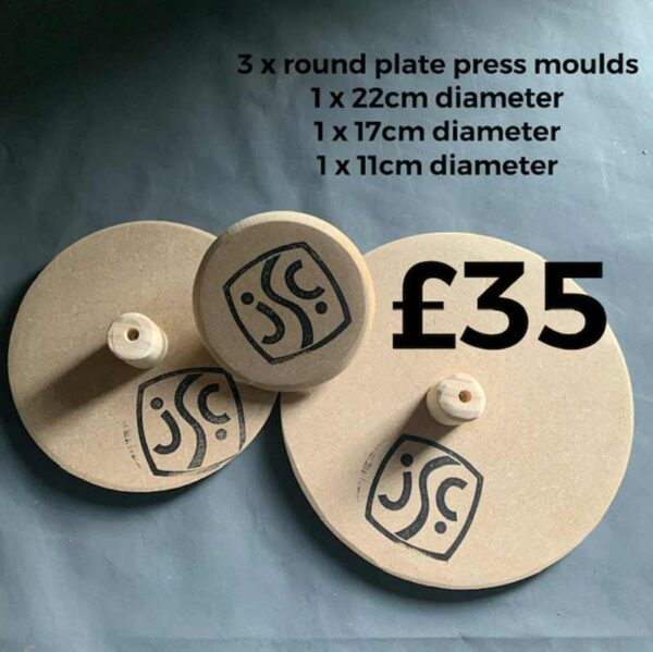 A set of round wooden clay moulds showing the back and front - for making ceramic plates