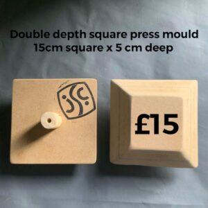 The back and front of a wooden square press ceramics mould