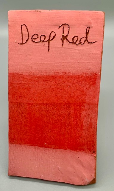 deep red colour decorating slip